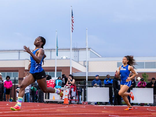 Middletown's Daija Lampkin (left) races to a win in the Division I Girls 400 Dash event at the DIAA Outdoor Track and Field Championships at Dover High School in Dover on Monday evening.