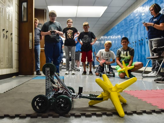 Students at the RAMTEC Vex Robotics Summer Camp watch as a fellow camper completes a challenge in which a robot is controlled to pick up a yellow star and drag it to a marked spot, then return to its staring position. One hundred and thirty-five middle and high school students attended the camp this week.