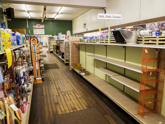 Store shelves are bare at Middletown Hardware as employees packed up inventory to move to the store's New Castle location on Wednesday afternoon.