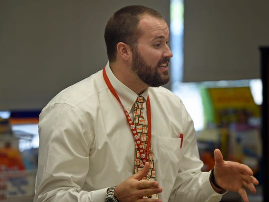 Drew Kyle talks to students during the Principal's Publishing Party on Thursday, Oct. 6, 2016 at St. Thomas Elementary School.