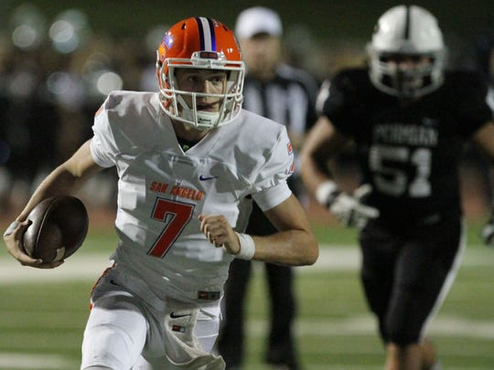 Former Central High School quarterback Cal Vincent runs for a large gain against Odessa Permian during last season's game at Ratliff Stadium.