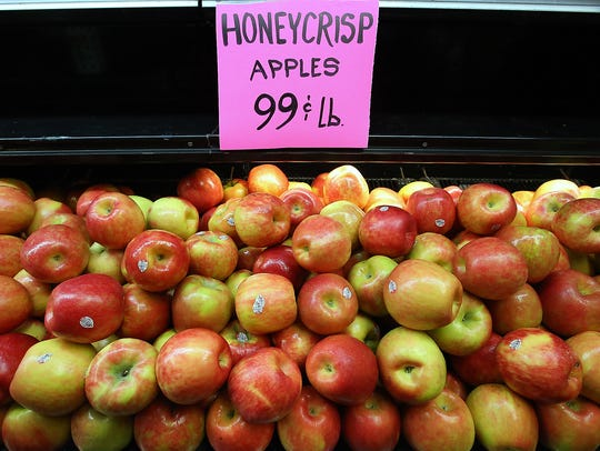 Honeycrisp apples line a shelf in the Olmsted's current location on Highway 305.