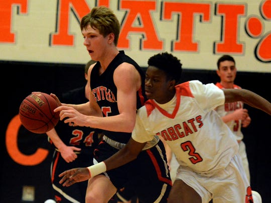 Northeastern's Quay Mulbah tries to strip the ball from Central York's Braden Richard in basketball action from last season. Both the Bobcats and the Panthers will be involved in holiday tournament basketball action this week. DISPATCH FILE PHOTO