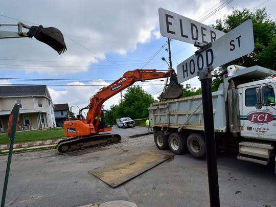 Fayetteville Contractors, Inc., works at Elder Street on Wednesday, May 30, 2018. Borough of Chambersburg is spending nearly $1 million on stormwater system, curbs and sidewalks on Elder Street before paving.