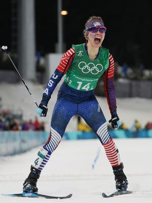 Jessica Diggins (USA) celebrates taking the gold medal in the ladies' cross-country skiing team sprint freestyle final during the Pyeongchang 2018 Olympic Winter Games at Alpensia Cross-Country Centre.