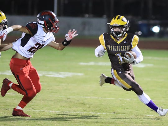 Golden West's Ian Kelly (1) attempts to turn up field