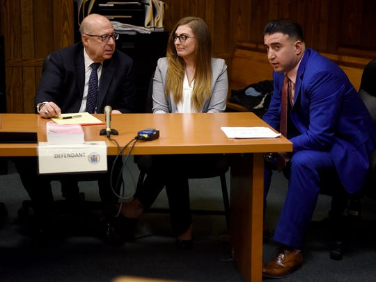 Keri Barry with her attorneys John Bruno Jr. on left,