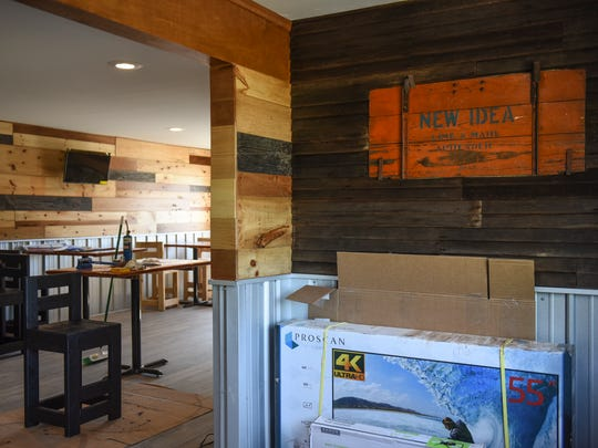 """Owners Jim and Kiley Hilligan describe the interior of ConfluxCity Brewing Company in Portland, Michigan as """"rustic industrial."""""""
