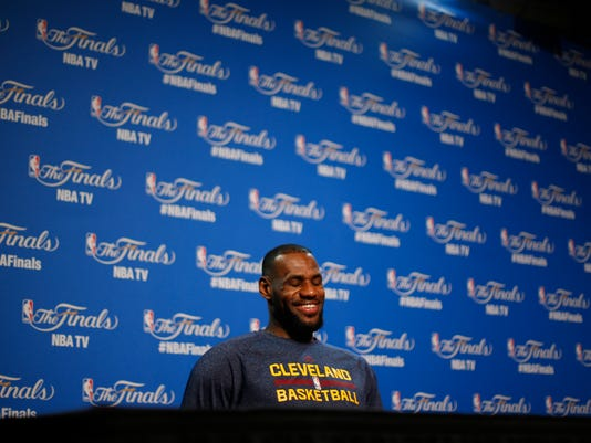 2abf8b8f8 Cleveland Cavaliers forward LeBron James smiles during a press conference  for basketball s NBA Finals in Cleveland