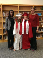 Kemar Prussien, left, a Cornell University student, with two Spencer-Van Etten Middle School sixth-grade students, Madison Drake and Jordan Tripp, and teacher Jeannette Luther at an Early College Awareness Acceptance Day Celebration in the school library in April 2015.