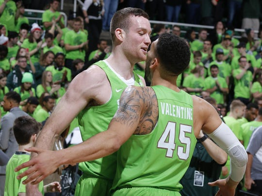 Michigan State's Matt Costello, left, and Denzel Valentine celebrate following Saturday night's 74-65 victory over Maryland in East Lansing.