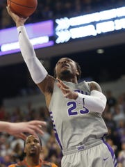 GCU's Carlos Johnson (23) makes a layup against Texas