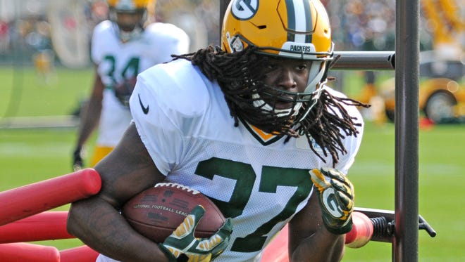 Green Bay Packers running back Eddie Lacy runs through drills during training camp practice at Ray Nitschke Field, Monday, July 28, 2014.