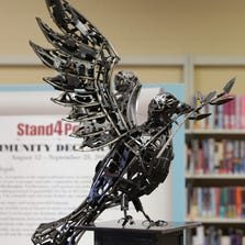 A peace dove sculpture, created by artist and IFD fire fighter, Ryan Feeney, created with seized gun parts, will tour Marion County Public Libraries.