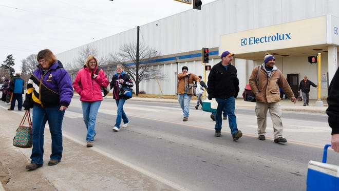 Employees walk to the parking lot after a shift change Tuesday, Jan. 30, at Electrolux in St. Cloud. Electrolux corporate officials announced that the St. Cloud facility, that manufactures Frigidaire upright freezers, will continue production through 2019.
