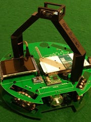 Brothers Alexander and Nicholas Kmosko of Flemington won the RoboCupJr USA Soccer Championship held at the Horace Mann School on May 21. This is their winning robot.