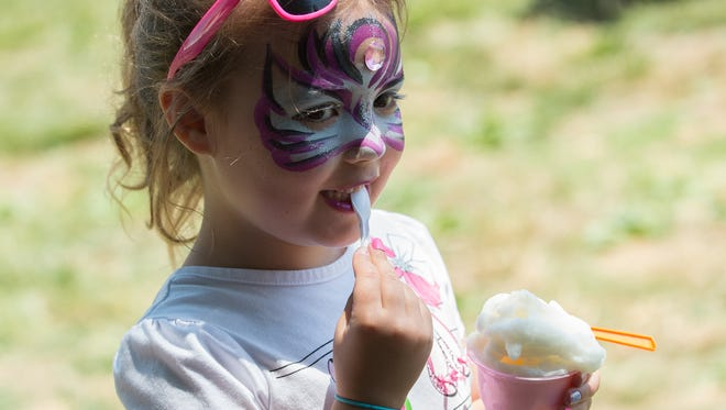 Vivienne Govatos, 5, of Wilmington enjoys a cold treat at the New Castle County Ice Cream Festival.