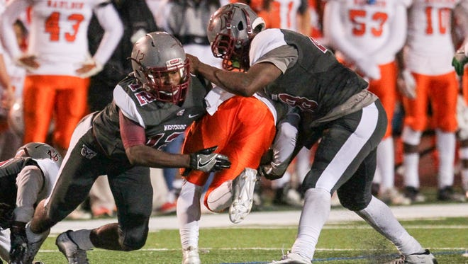 Westside's Kiante Miller (12), left, and Nick Burton tackle Mauldin's Dre Harris (1) during the fourth quarter on Friday at Westside High School in Anderson. The Rams host No. 8 Dorman this week.