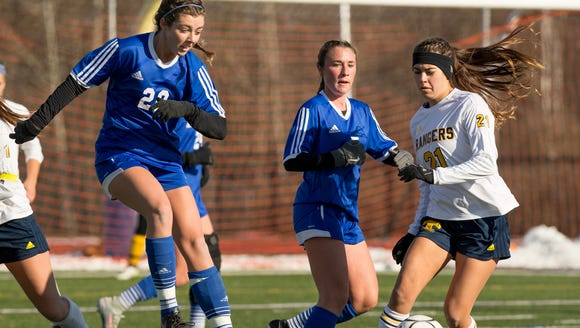 Pearl River's Cate Feerick, center, plays the ball
