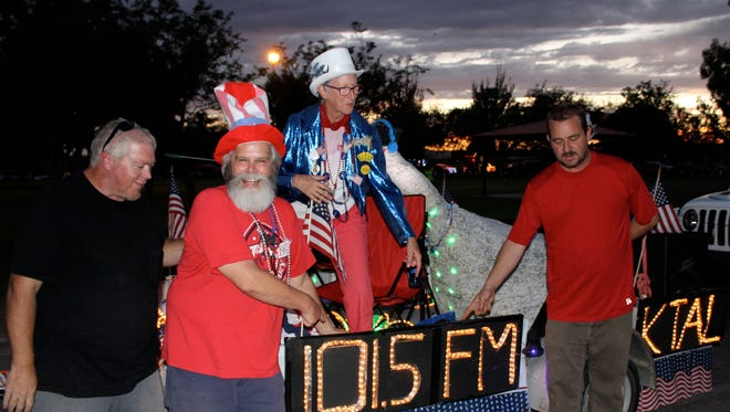From left, board members Dave Wheeler, Bruce Ernst, Linda Hall and Corey Asbill get ready to launch the KTAL-FM float at Apodaca Park during the 2018 Electric Light Parade on July 3.