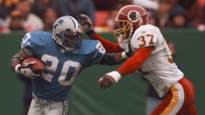 Detroit Lions running back Barry Sanders plays against the Washington Redskins on Nov. 9, 1997.