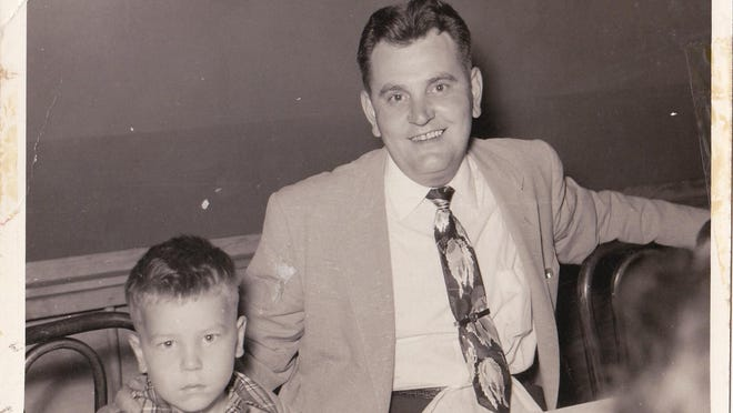 David McGrath pictured with his father in 1955