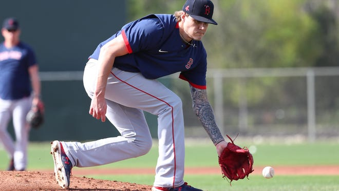 Pitcher Tanner Houck works on his fielding during a drill at spring training in February. He pitched for the PawSox last year and was among those pool players who were assigned to Pawtucket on Friday.