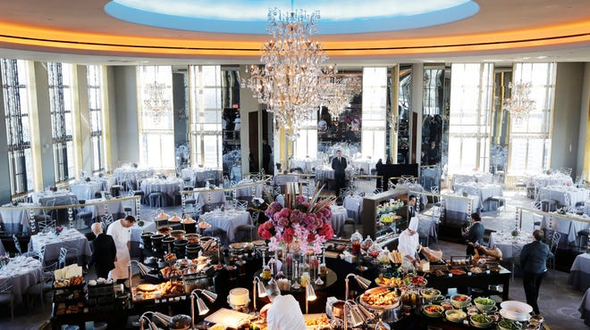 Chefs prepare a lavish spread before lunchtime guests arrive at the Rainbow Room, New York City's landmark restaurant atop 30 Rockefeller Plaza on Sunday,. The Rainbow Room reopened Sunday after a five-year absence.