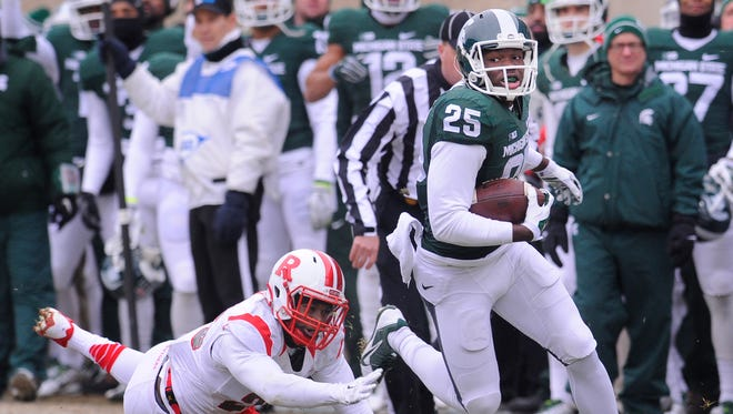 MSU receiver Keith Mumphery  escapes Rutgers'  Nadir Barnwell  for a first down after a reception in East Lansing Saturday 11/22/2014.