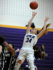 Wylie's Julia Lovelace (34) puts up a shot over Big