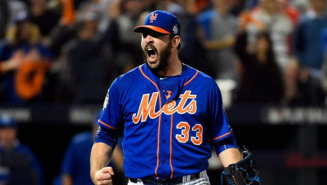 New York Mets starting pitcher Matt Harvey reacts after striking out the side in the fourth inning in game five of the World Series against the Kansas City Royals at Citi Field on Nov 1, 2015.