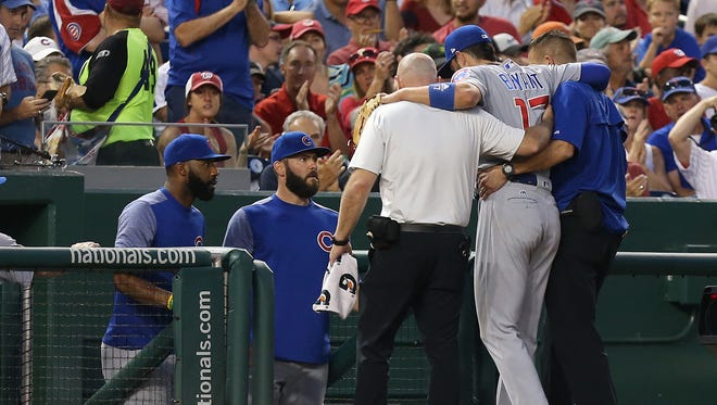 Kris Bryant is helped off the field after injuring his ankle.