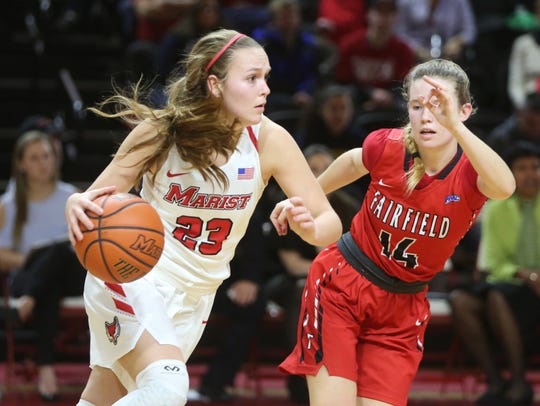 Marist College's Rebekah Hand drives past a Fairfield