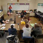 Students listen in math class Thursday at the Mansfield Adult Education Center.