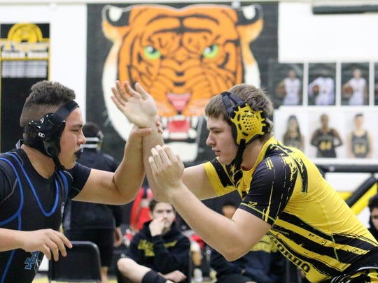 Alamogordo's Zac Collins, right, squares off with a wrestler from Santa Teresa on Saturday.