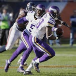 Minnesota Vikings quarterback Teddy Bridgewater (5) hands off to running back Adrian Peterson (28) during the second half of the Nov. 1 game against the Chicago Bears in Chicago.