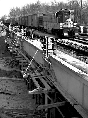 The first train rolled along the new NC & St. L Railroad Overpass near Christian Brothers College on Nov. 27, 1952, marking completion of an important phase of the modernization project along East Parkway. The entire section from Central to Union is expected to be ready for use by Christmas.
