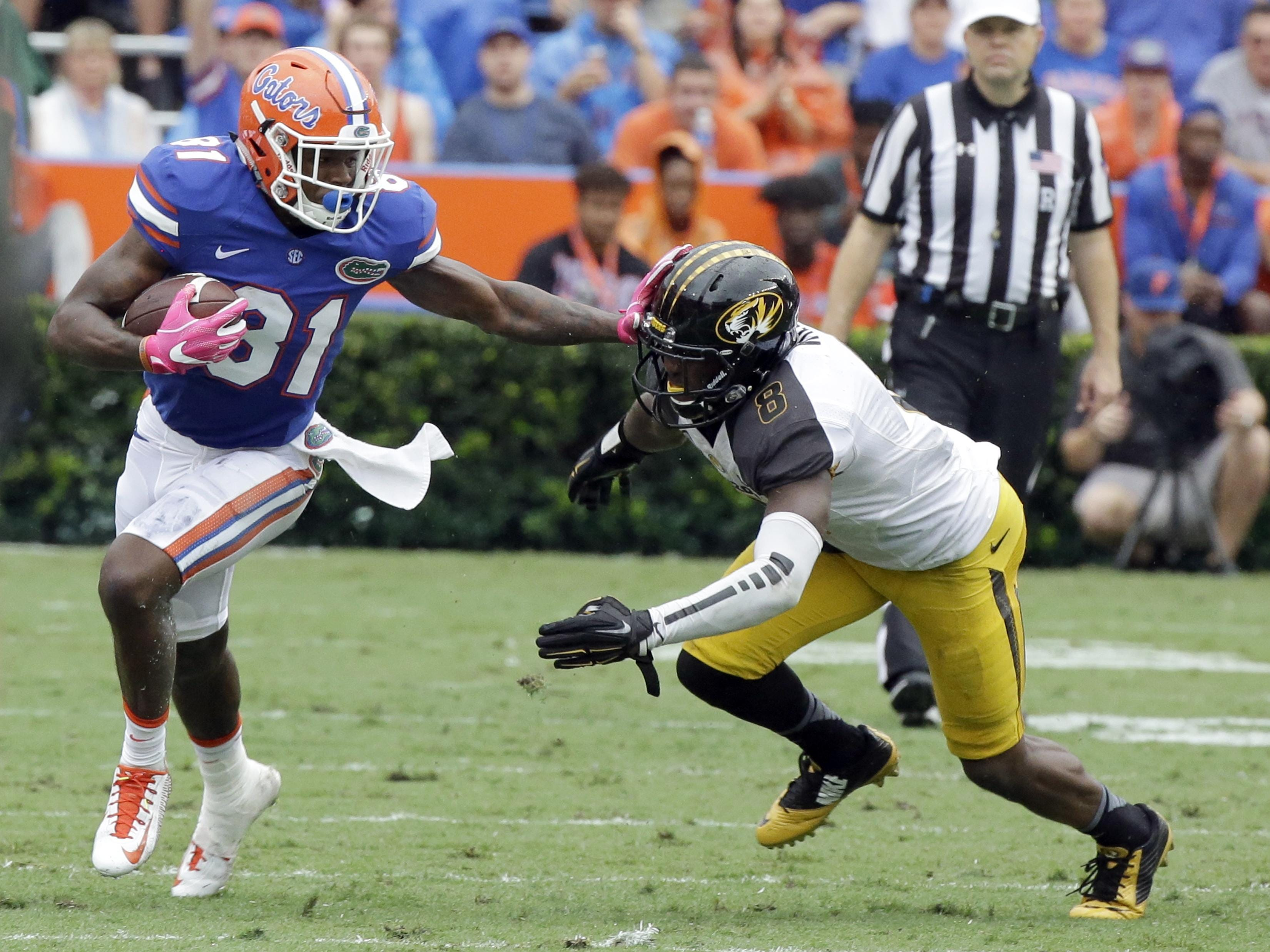 Florida wide receiver Antonio Callaway (81) tries to get around Missouri safety Thomas Wilson after a reception in the first half of an NCAA college football game, Saturday, Oct. 15, 2016, in Gainesville, Fla. (AP Photo/John Raoux)