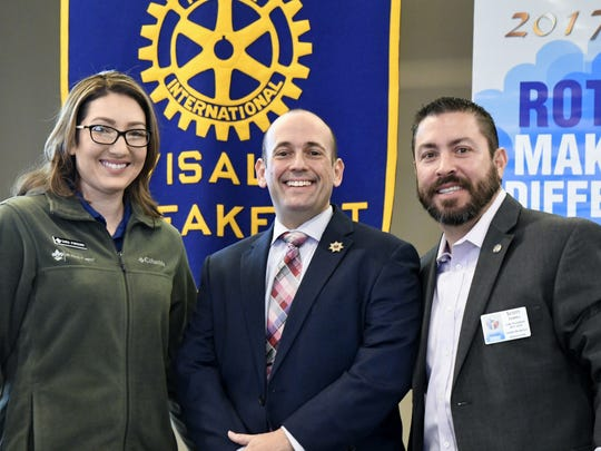 Sara Parsons, Boy Scouts of America Sequoia Council district executive, Rodney Blaco with the Tulare County District Attorney's Office, and Scott James, Visalia Breakfast Rotary Club president, pose for a photo at the Visalia Rotary meeting Thursday morning.
