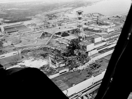 An aerial view of Ukraine's Chernobyl nuclear power plant, the site of the world's worst nuclear disaster, is seen in this May 1986 file photo made a few days after the April 26 deadly explosion. In front of the chimney is the destroyed 4th reactor.