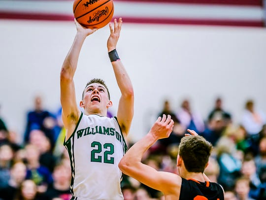 Riley Lewis ,22, of Williamston knocks down a jump