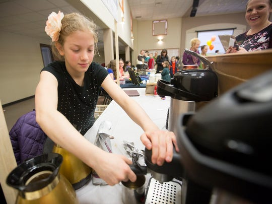 Emily Lewerenz, 10, of Weston makes a latte at her booth, Do-Re-Mi-Fa-So-Latte at the Kids Awesome Business Fair at Mount Olive Lutheran Church in Weston, Friday, April 8, 2016.