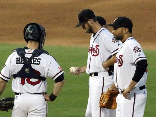 El Paso Chihuahuas pitcher Justin Hancock, center, is met at the mound by teammates before being relieved by Aaron Northcraft after the Reno Aces took an early 6-0 lead Saturday night at Southwest University Park.