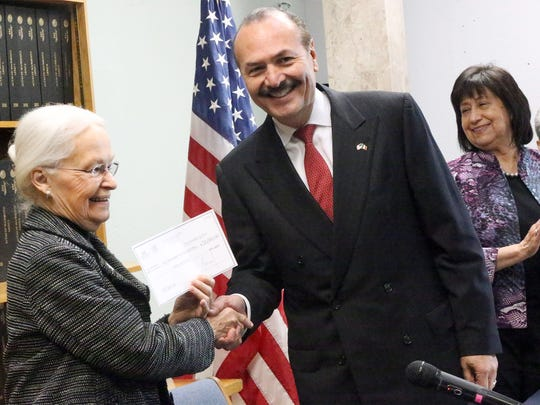 Marcos Bucio, center, consul general of Mexico in El Paso, presents scholarship checks to University of Texas at El Paso President Diana Natalicio, left, and Jenny Giron, right, vice president for information technology and chief information officer for El Paso Community College during a ceremony Tuesday at the Mexican Consulate in Downtown El Paso.