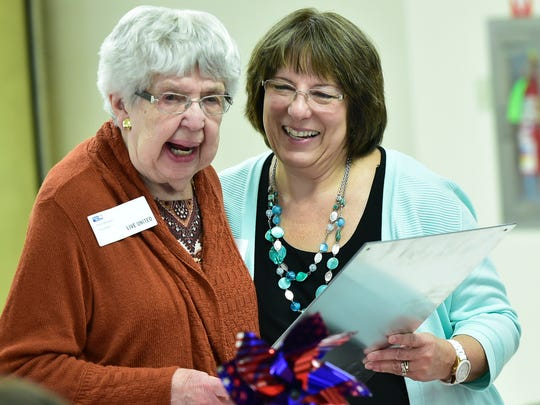 Cheri Kearney, community impact director, right, presents the Cynthia Hawbaker Award to Doris Mickey for her United Way of Franklin County Campaign contributions. A total amount raised of $933,200 was announced during an annual celebration on Wednesday, March 22, 2017. The awards luncheon was held at Eugene C. Clarke Jr. Community Center, Chambersburg.
