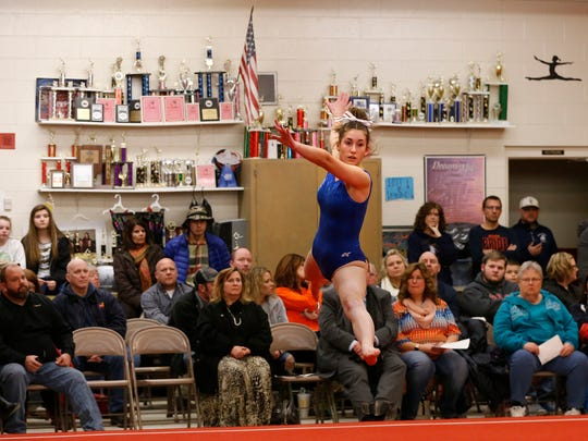 Mia Clark of Harrison competes in the floor exercise