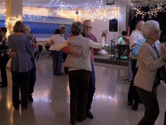 Couples dance at the Country-Western Live Band Dance