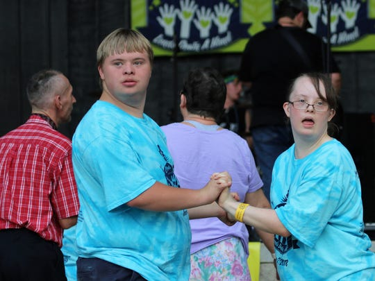 A couple of students from the West Tennessee Down Syndrome Association and Camp Imaginarium dance during last year's Country Music Lends Down a Hand concert.