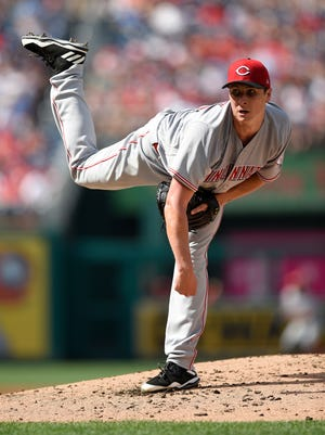 Cincinnati Reds starting pitcher Homer Bailey follows through on a pitch during the first inning of a baseball game against the Washington Nationals, Saturday, June 24, 2017, in Washington.