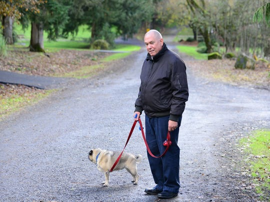 Dr. Peter Rasmussen takes his dog, Pugsley, for a walk